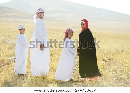 Arabic family in nature - stock photo