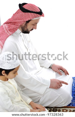 Arabic father and son praying together - stock photo