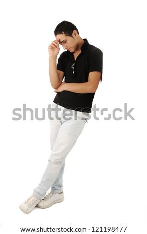 Arabic guy leaning against the wall having an idea - stock photo