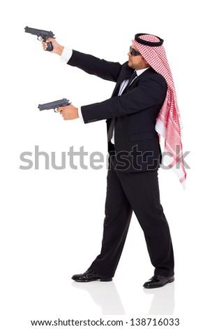 arabic hitman holding guns on white background - stock photo