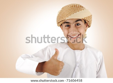 Arabic kid with thumb up [May be offesive gesture in Middle Eastern Countries and Internationally] - stock photo