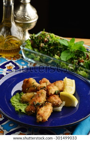 Arabic / Lebanese style chicken wings glazed with a lemon and tabbouleh salad - stock photo