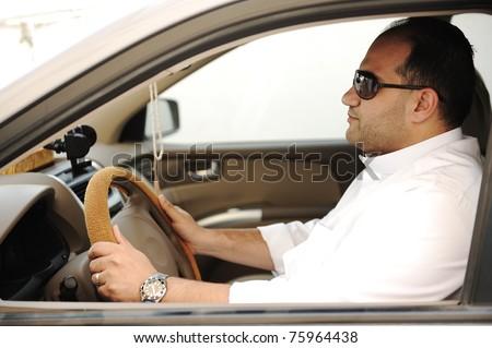 Arabic man driving a car - stock photo