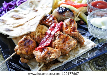 Arabic mixed barbeque plate with sauces and multiple garnish. - stock photo