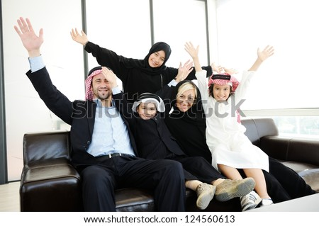 Arabic Muslim family with kids happy at home - stock photo