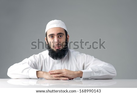 Arabic Muslim man with a bushy beard  - stock photo