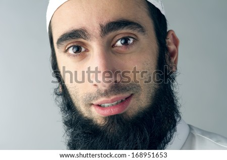 Arabic Muslim man with beard portrait - stock photo