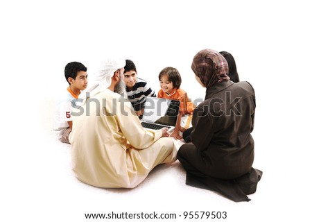Arabic Muslim teacher with children students - stock photo