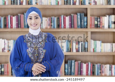Arabic muslim teenage student inside the high school library - stock photo