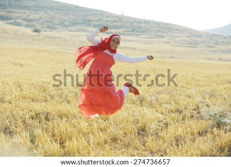 Arabic people enjoying on beautiful field - stock photo