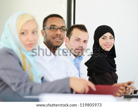 Arabic people having a business meeting with a selective focus - stock photo