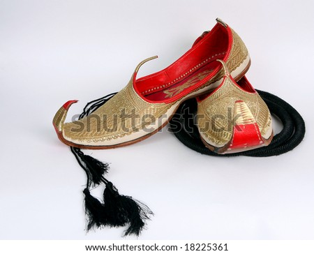 Arabic slippers on white background. - stock photo