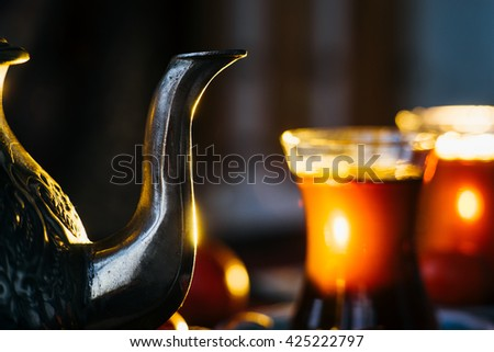 Arabic tea ceremony. Close-up of the tea spout - stock photo