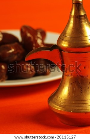 arabic teapot and dates in the background - stock photo