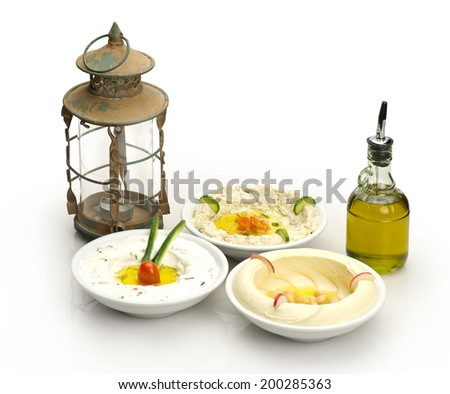 Arabic traditional Hummus , labneh and mtabbal with Ramadan Lamp   - stock photo