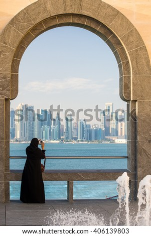 Arabic Woman looking at Doha Landscape, Qatar - stock photo