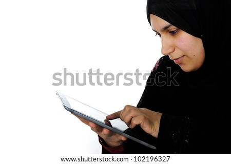 Arabic woman working with touch tablet - stock photo