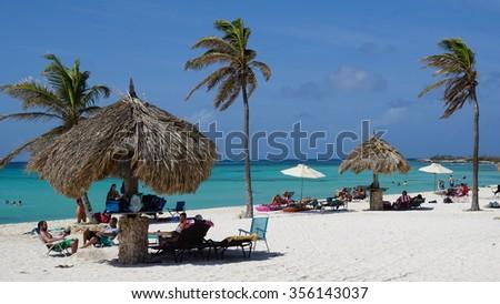 ARASHI, ARUBA - NOV 26: Arashi Beach in Aruba, as seen on Nov 26, 2015. Arashi is Blue Flag certified, part of a program to promote green behavior and increase eco-awareness on the island. - stock photo