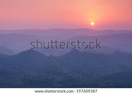 Aravalli mountains near Udaipur on sunset, Rajasthan, India - stock photo