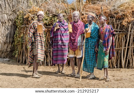 ARBORE, ETHIOPIA, 13 AUGUST: group of unidentified old men from Arbore Tribe on august 13, 2014. Arbore tribe people are endangered because of oil field near their villages - stock photo