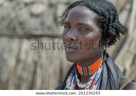 ARBORE, ETHIOPIA, 13 AUGUST:unidentified woman from Arbore tribe in Arbore, Ethiopia, on 13 august 2014. Arbore women use a lot of bead necklaces as personal decoration - stock photo