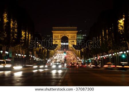 Arc de Triomphe and Champs-Elysees Avenue in Paris at dusk - stock photo