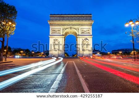 Arc de Triomphe at night in Paris, France.  - stock photo
