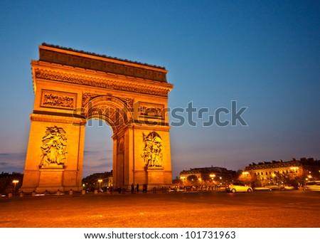 Arc de Triomphe de l'Etoile on dusk, Paris - stock photo