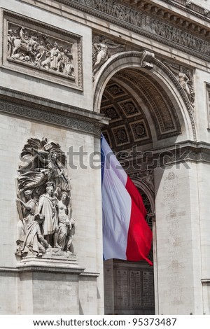 Arc de Triomphe detail showing the french flag flying from underneath - stock photo