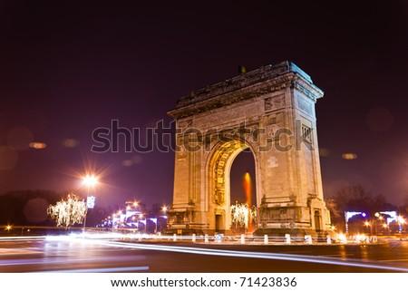 Arc De Triomphe in the night, Bucharest, Romania - stock photo