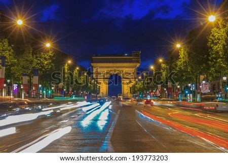 Arc de triomphe Paris (Arch of Triumph and Champs Elysees) at sunset - stock photo