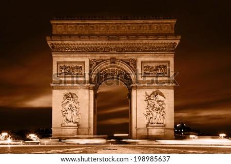 Arc de Triomphe, Paris, France. View from Avenue des Champs-Elysees. Vintage retro style, monochrome. - stock photo
