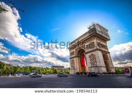 arc de tromphe under blue sky - stock photo