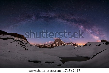 Arc of the milky way over mount Midi, Pirenees, France - stock photo