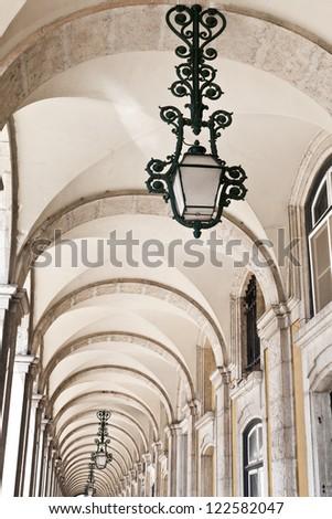 Arcade and Lamp at the Commerce Square (Praca do Comercio), Lisbon, Portugal - stock photo