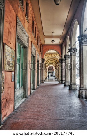 arcade in Bologna, Italy. Processed for hdr tone mapping effect - stock photo