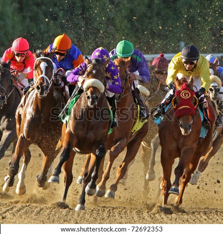 ARCADIA, CA - MAR 5: Jockeys round the turn and head down the homestretch in a race at Santa Anita Park on Mar 5, 2011 in Arcadia, CA. - stock photo