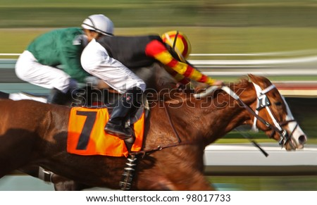 "ARCADIA, CA - MARCH 15: Christian Santiago Reyes and ""Siempre Esperanza"" surge ahead to place 2nd in a maiden race at Santa Anita Park on March 15, 2012 in Arcadia, CA. - stock photo"