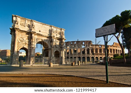 Arch and Colosseum - stock photo