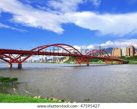Arch bridge on river - stock photo