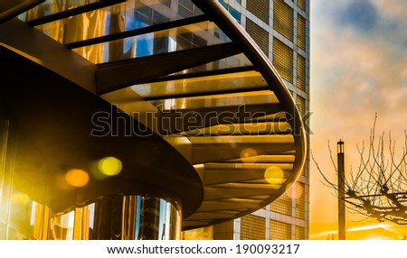 Arch canopy of modern building at colorful sunset - stock photo