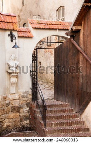 Arch entrance to old yard in historic part of Lviv, Ukraine - stock photo