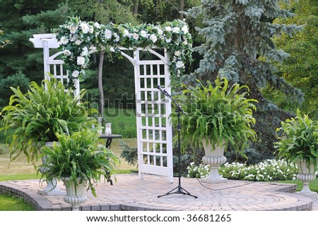 arch gate with flowers - stock photo