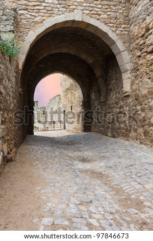 arch in old stoned fortress - stock photo