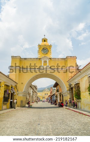 arch in the colonial city of antigua city in guatemala - stock photo
