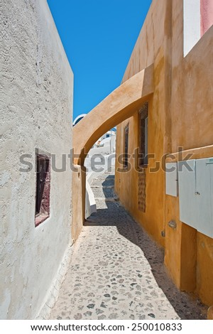 Arch of a narrow street in Oia, Santorini island, Greece - stock photo