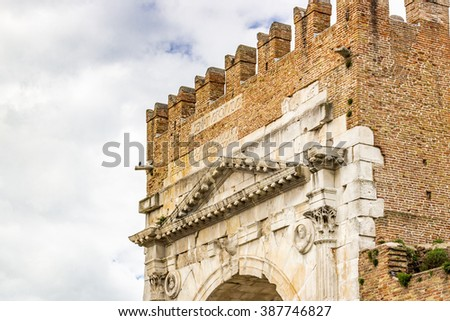Arch of Augustus, an ancient Roman gateway to the city of Rimini in Italy - stock photo