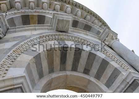 Arch part of the Leaning Tower in Pisa, Italy - stock photo