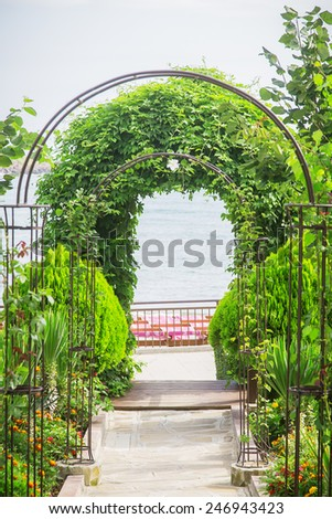 arch plants way to the sea - stock photo