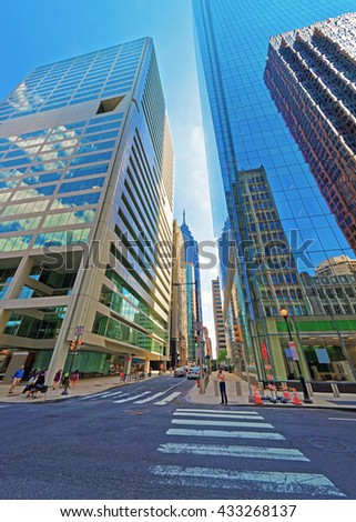 Arch Street view with skyscrapers reflected in glass in the City Center of Philadelphia, Pennsylvania, USA. It is central business district in Philadelphia. Tourists in the street - stock photo